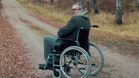 medicals : Disabled man in wheelchair on the road waiting for assistance