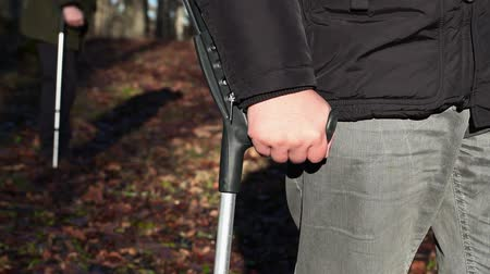 kule : Disabled man with crutches
