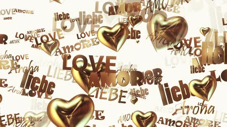 годовщина : Inscriptions Love in various languages with hearts in golden color on white