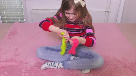 balçık : Little girl take fun with two colorful slimes