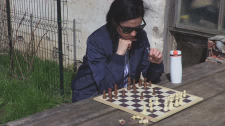 know : Woman thinking near chess board Stock Footage