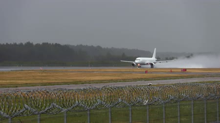 landing field : Commercial airplane on the runway in rainy day