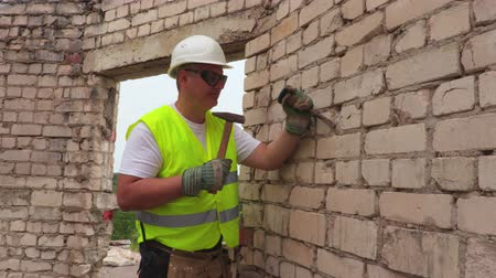 manual work : Construction worker using hammer and chisel