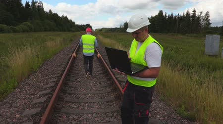train workers : Engineer and worker on railway track