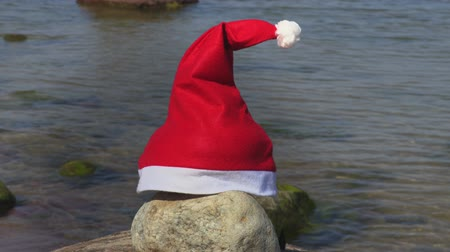mikulás : Santa Claus hat on the sea background