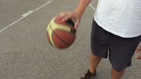 hoop : Basketball player dribbles the ball