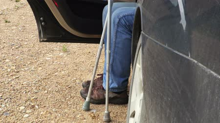 kule : Disabled with crutches get out of car