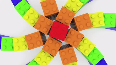Star built from toy bricks in various colors on white background