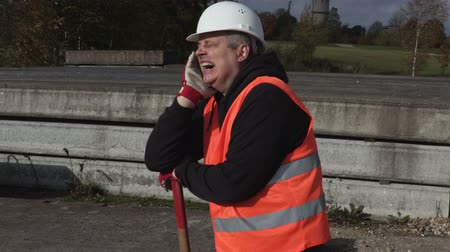 vest : Lazy worker yawning Stock Footage
