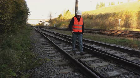 Railway Engineer  walk on railway rails Dostupné videozáznamy