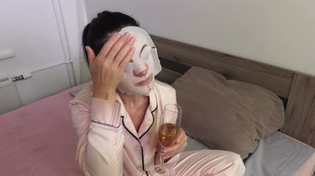 Woman with facial mask and wine glass Dostupné videozáznamy
