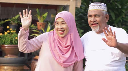 malaya : Happy senior couple waving