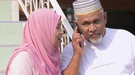 malaya : Senior couple talking on the phone