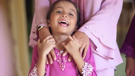 religião : Happy girl with mother during Eid celebrations