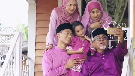 ailelerin : Muslim family taking selfie outside the house