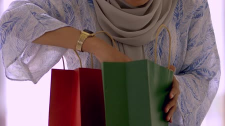 Woman checking the gift bags