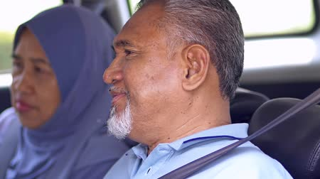 Senior Muslim couple sitting in a car Stock Footage