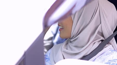 Muslim woman in a car Stock Footage
