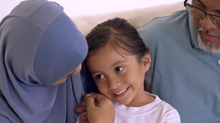 malaya : Young Muslim girl and her grandparents spending time together