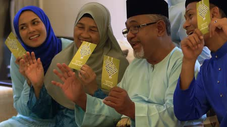 Muslim family with green envelopes Stock Footage