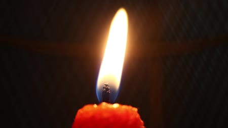 resourceful : Close-up shot of a flaming candle Stock Footage