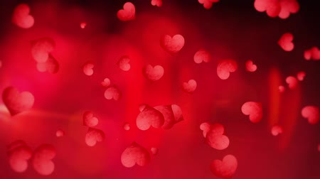 романтика : Hearts floating on red Valentines day background Стоковые видеозаписи