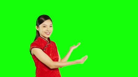 chinese culture : Cheerful woman in traditional clothing showing hand gesture