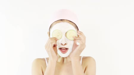 лицевой : Woman with facial mask applied on face Стоковые видеозаписи