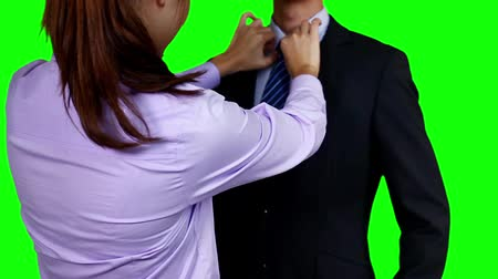 oblek : Woman adjusting businessmans tie