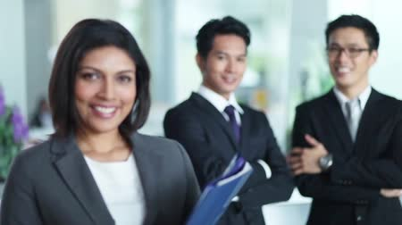 asian and indian ethnicities : Businessmen and businesswoman looking at camera