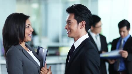 indian ethnicity : Businesswoman having conversation with businessman