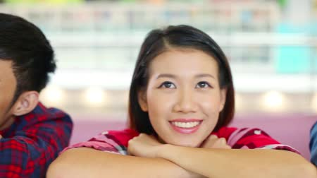 asian and indian ethnicities : Faces of cheerful young students Stock Footage