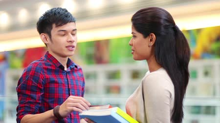 indian ethnicity : Two friends discussing at library Stock Footage