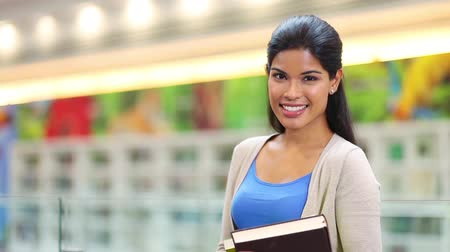 asian and indian ethnicities :  A cheerful young student looking at camera Stock Footage