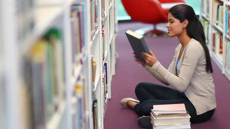 asian and indian ethnicities : Young student reading a book Stock Footage