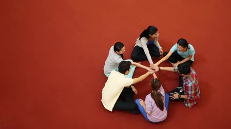 asian and indian ethnicities : Young students having a team huddle
