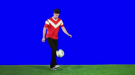 A soccer fan doing a simple skill with a ball