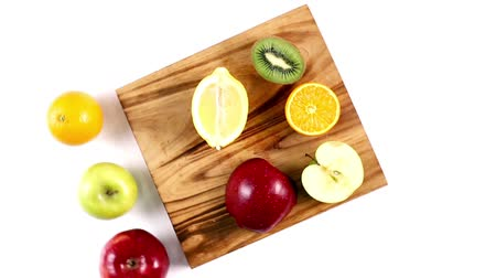 kesme tahtası : Cut fruits and knife on the chopping board