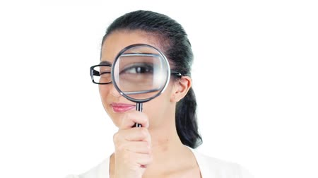 только один человек : Footage of young woman looking through the magnifying glass