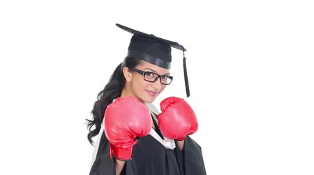 bokszoló : Footage of graduated young woman wearing boxing gloves
