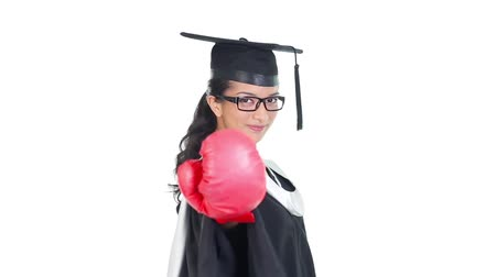 csak a fiatal nők : Footage of graduated young woman wearing boxing gloves
