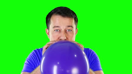 balonlar : Mid adult man blowing balloon until it exploded Stok Video