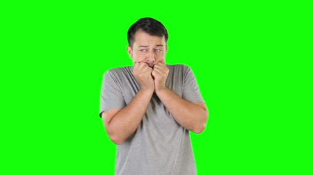 morder : Frightened mid adult man biting nails Stock Footage