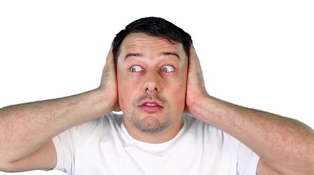 потрясенный : Mid adult man covering his ears Стоковые видеозаписи