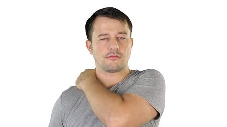 omuzlar : Mid adult man is massaging his shoulder