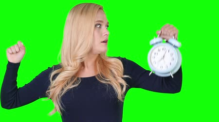 csak a nők : Young adult woman is yawning while holding alarm clock