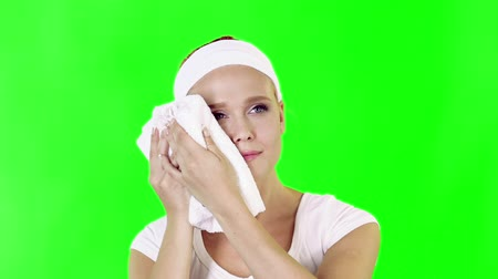 towel : Young adult woman dab her face with a towel