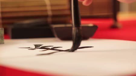 ano novo chinês : Writing chinese calligraphy goat  Vídeos