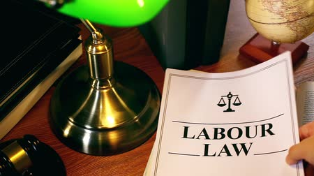 holding onto : Lawyer Putting Labour Law Document Onto Table Stock Footage