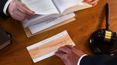 cheque : Lawyer rejecting cheque as a bribe Stock Footage